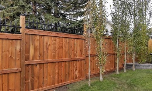 Brown Treated Fence with Ornamental Top Calgary's Best Fence Builder