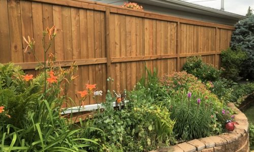 Brown Treated Fortress Fence Calgary's Best Fence Builder